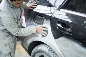 car painter preparing car for new paint